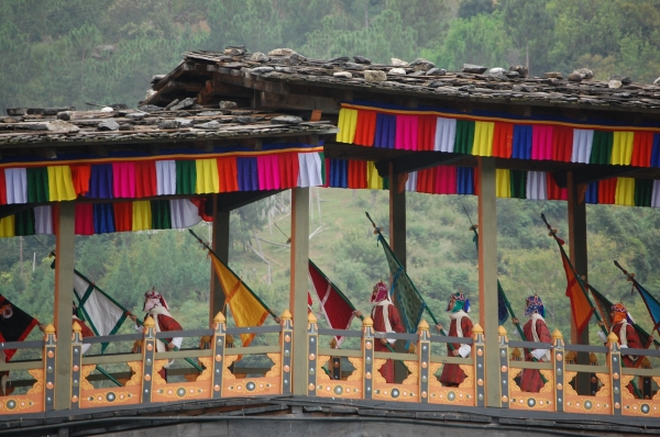 The Royal Wedding procession begins on the bridge crossing the Mochu River at Punakha Dzong, Bhutan.